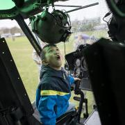 Young boy in helicopter at 2016 MIT Open House